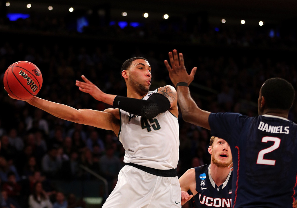 . Denzel Valentine #45 of the Michigan State Spartans handles the ball against DeAndre Daniels #2 of the Connecticut Huskies during the East Regional Final of the 2014 NCAA Men\'s Basketball Tournament at Madison Square Garden on March 30, 2014 in New York City.  (Photo by Elsa/Getty Images)