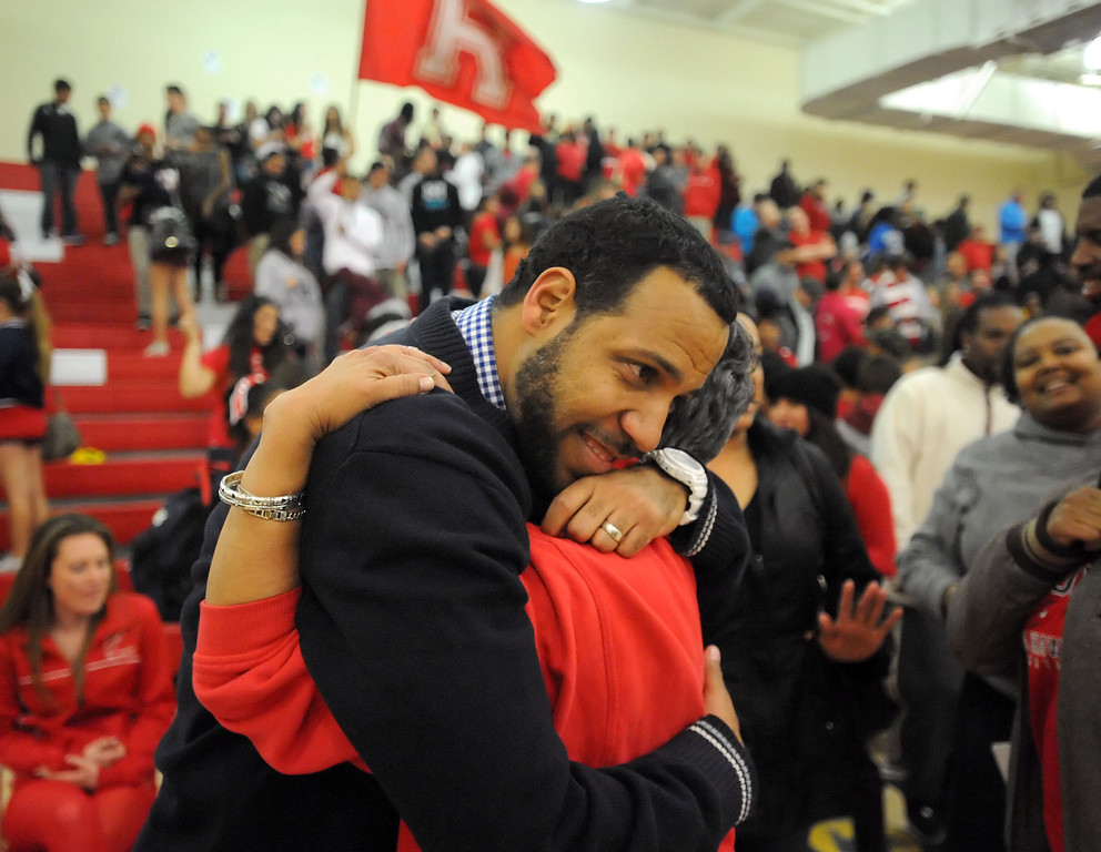 . Redondo Union first year coach Reggie Morris, Jr., gets a hug from his mother Leslie Gittens after Redondo beat Arroyo Grande 55-41 in a CIF Southern Section Division II-A semifinal boys basketball game Tuesday night in Redondo Beach. 20130226 Photo by Steve McCrank / Staff Photographer