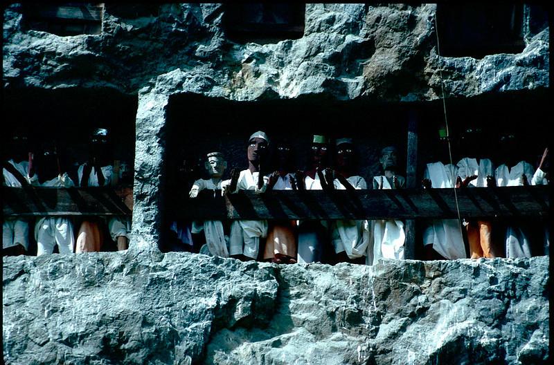 Toraja pray to their Tau Taus