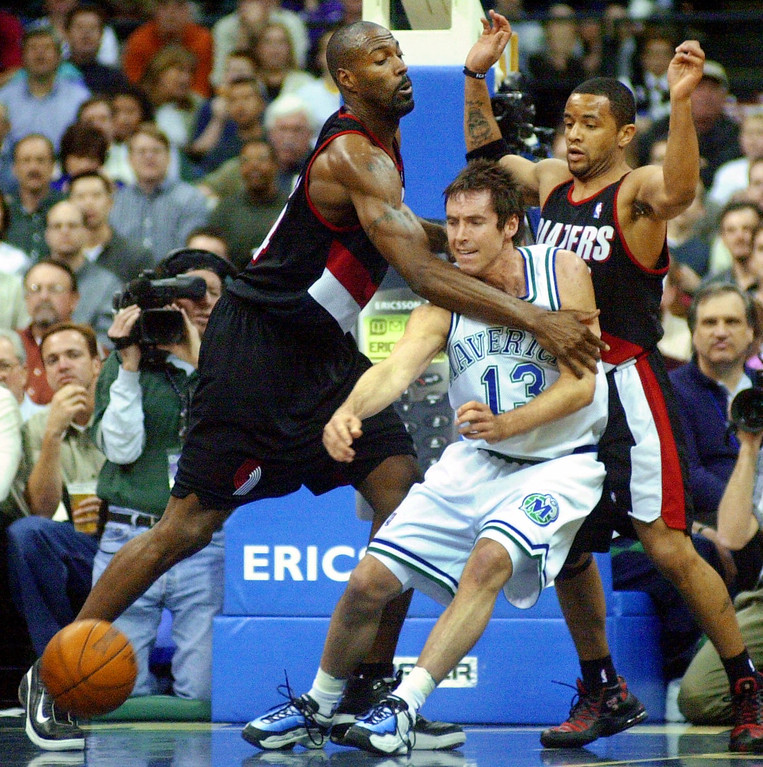 . Portland Trail Blazers forward Dale Davis, left, fouls Dallas Mavericks guard Steve Nash (13) as Nash tries to take the ball against Davis and Trail Blazers guard Damon Stoudamire in the first quarter in Dallas, Tuesday, March 20, 2001. (AP Photo/Bill Janscha)