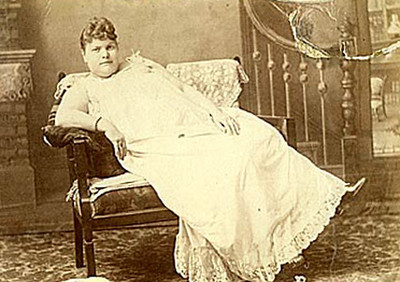 """You're right.  This WASN'T taken at the historical society meeting.  This is an unidentified """"lady of the night"""" in a photo from turn-of-the-century Deadwood.  Photo courtesy of  Deadwood Illustrated."""