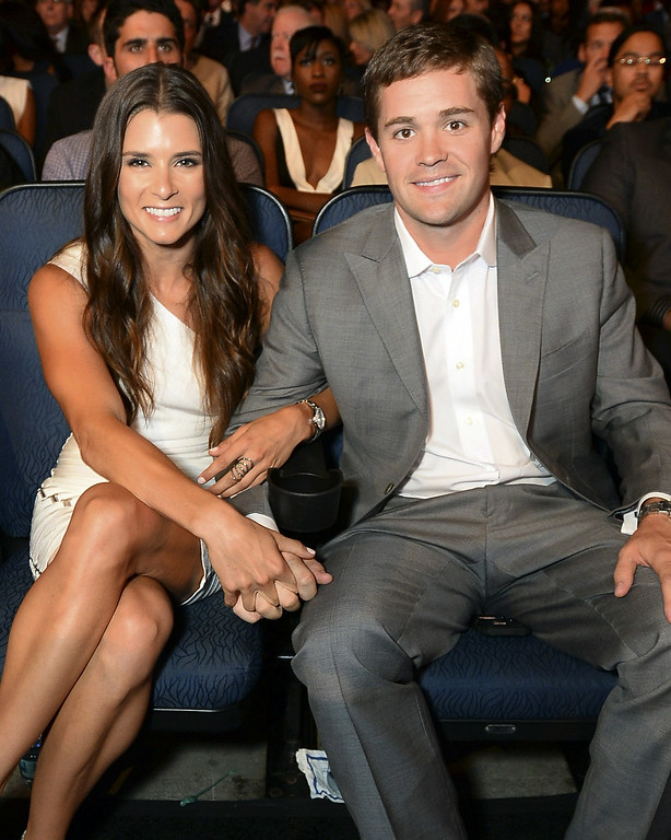 . Racers Danica Patrick, left, and Ricky Stenhouse Jr. pose in the audience at the ESPY Awards at the Nokia Theatre on Wednesday, July 16, 2014, in Los Angeles. (Photo by Jordan Strauss/Invision/AP)