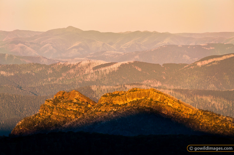 Mt Feathertop looms in the distance, with The Razor in the mid-ground - from Mt Speculation at sunset