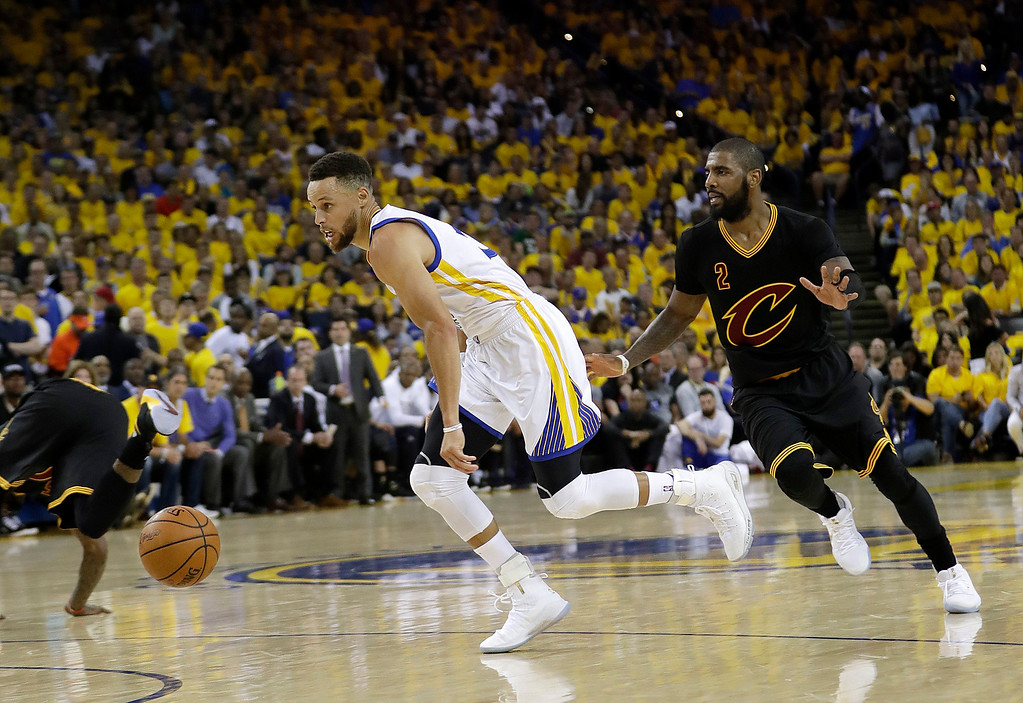 . Golden State Warriors guard Stephen Curry, left, dribbles past Cleveland Cavaliers guard Kyrie Irving (2) during the first half of Game 2 of basketball\'s NBA Finals in Oakland, Calif., Sunday, June 4, 2017. (AP Photo/Marcio Jose Sanchez)