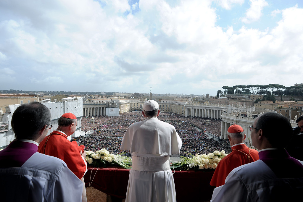. In this photo provided by the Vatican newspaper L\'Osservatore Romano, Pope Francis delivers the Urbi et Orbi (to the city and to the world) blessing, in St. Peter\'s Square at the Vatican, Sunday, March 31, 2013. Pope Francis celebrated his first Easter Sunday Mass as pontiff in St. Peter\'s Square, packed by joyous pilgrims, tourists and Romans and bedecked by spring flowers.Wearing cream-colored vestments, Francis strode onto the esplanade in front of St. Peter\'s Basilica and took his place at an altar set up under a white canopy. (AP Photo/L\'Osservatore Romano)
