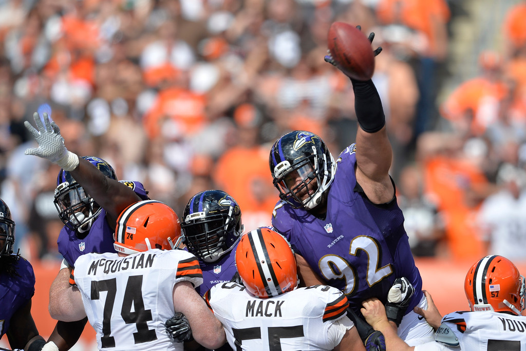 . Baltimore Ravens nose tackle Haloti Ngata (92) reaches for the ball on a missed field goal attempt by the Cleveland Browns during an NFL football game Sunday, Sept. 21, 2014, in Cleveland. Baltimore won 23-21. (AP Photo/David Richard)