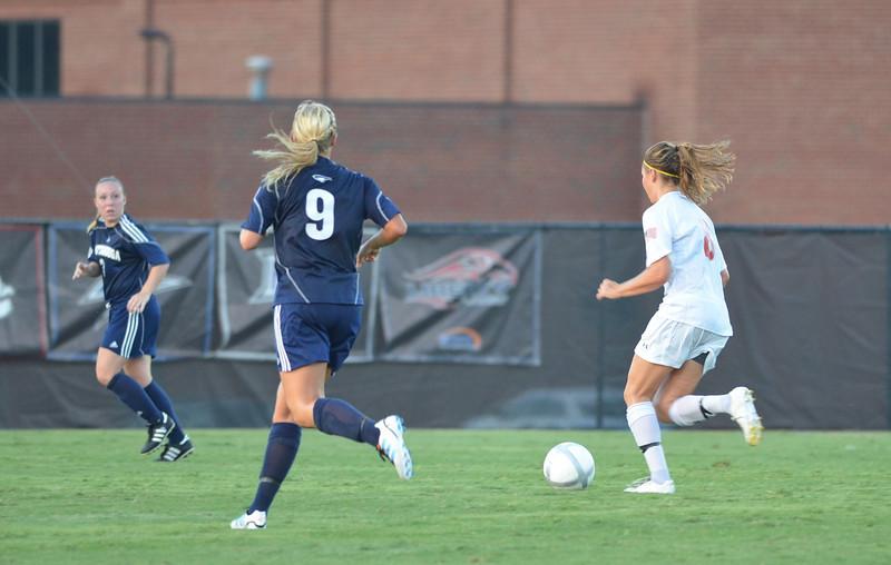 Megan Curan (8) dribble's the ball down the field while battling through Chattangooa's teammates.