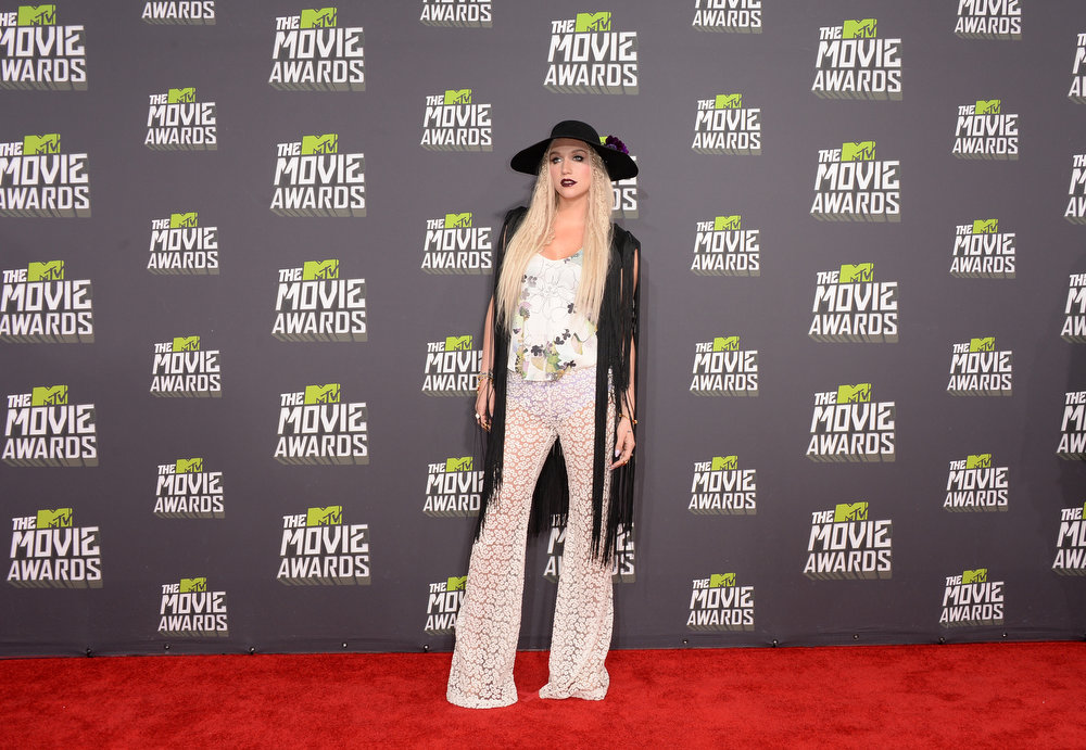 . Singer Ke$ha arrives at the 2013 MTV Movie Awards at Sony Pictures Studios on April 14, 2013 in Culver City, California.  (Photo by Jason Merritt/Getty Images)