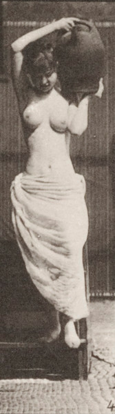Semi-nude woman descending stairs and turning holding a water jar on her left shoulder