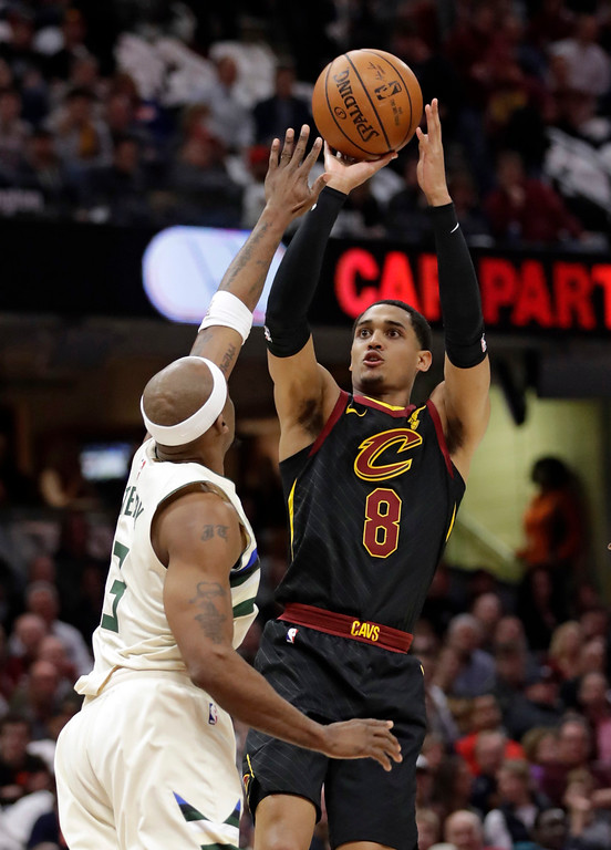 . Cleveland Cavaliers\' Jordan Clarkson (8) shoots over Milwaukee Bucks\' Jason Terry (3) in the first half of an NBA basketball game, Monday, March 19, 2018, in Cleveland. (AP Photo/Tony Dejak)