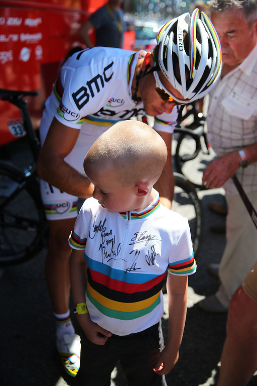 . AIX-EN-PROVENCE, FRANCE - JULY 04:  Philippe Gilbert, world road race champion. of Belgium and BMC Racing Team signs an autograph prior to stage six of the 2013 Tour de France, a 176.5KM road stage from Aix-en-Provence to Montpellier, on July 4, 2013 in Aix-en-Provence, France.  (Photo by Bryn Lennon/Getty Images)