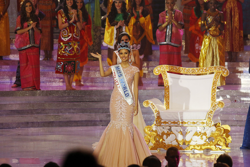 . Miss Philippines, Megan Young waves as she is crowned Miss World during Miss World 2013 on September 28, 2013 in Nusa Dua, Indonesia.  (Photo by Ed Wray/Getty Images)