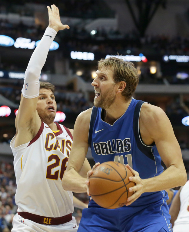 . Dallas Mavericks forward Dirk Nowitzki (41) looks to shoot against Cleveland Cavaliers guard Kyle Korver (26) during the second half of an NBA basketball game in Dallas, Saturday, Nov. 11, 2017. (AP Photo/LM Otero)
