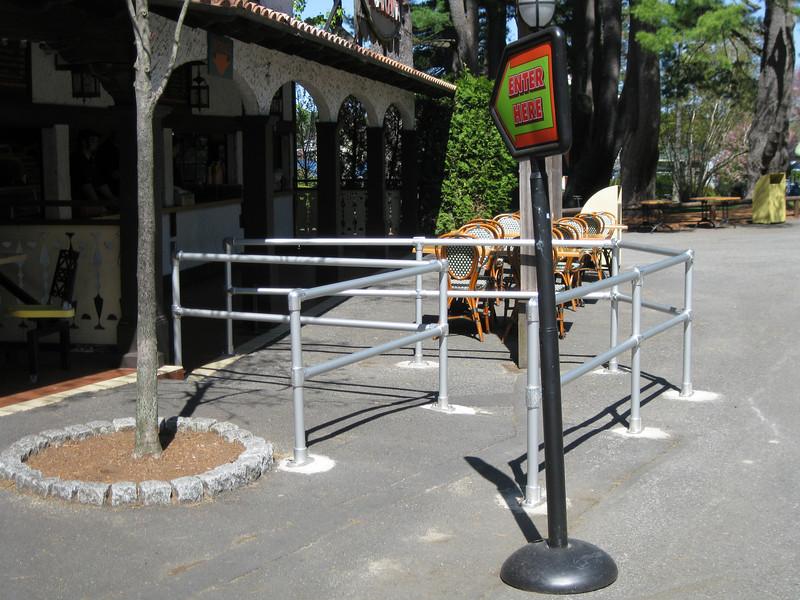 Queue railing at the Poncho Cantina entrance.