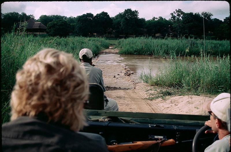 riding jeep across river