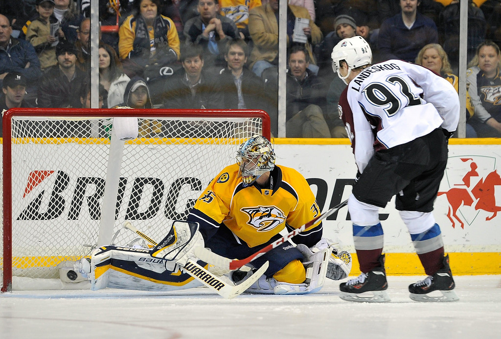 . NASHVILLE, TN - MARCH 25:  Gabriel Landeskog #92 of the Colorado Avalanche scores the game winning shoot out goal against goalie Pekka Rinne #35 of the Nashville Predators at Bridgestone Arena on March 25, 2014 in Nashville, Tennessee.  (Photo by Frederick Breedon/Getty Images)