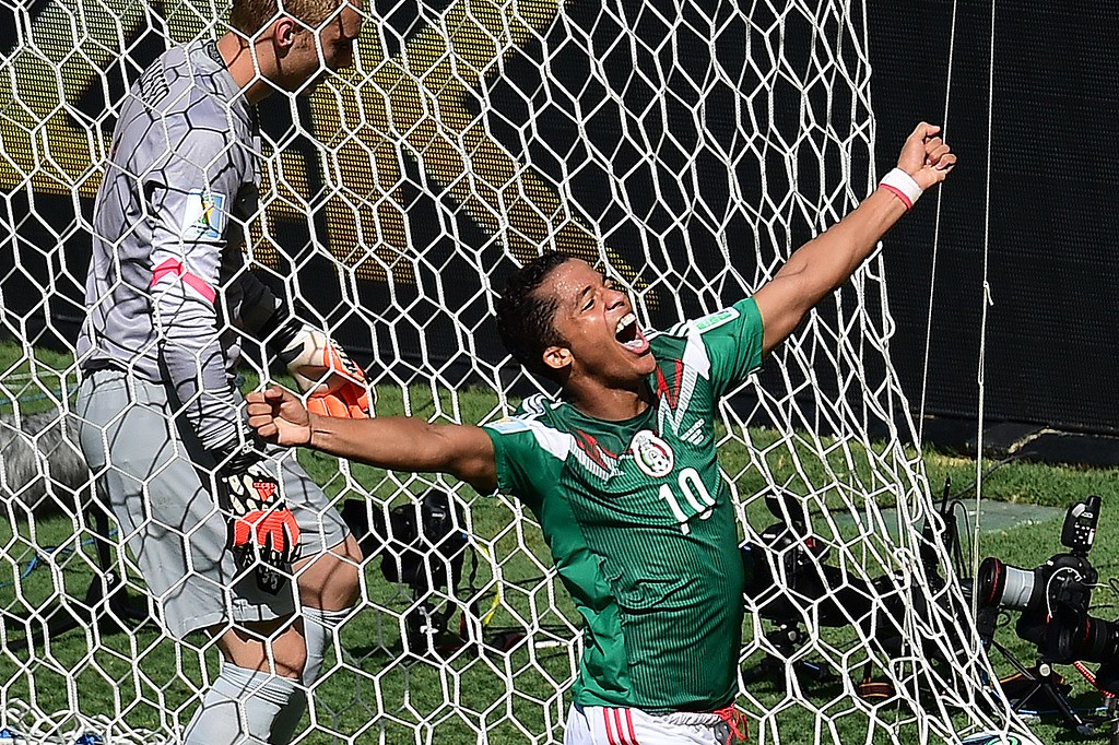 . Mexico\'s forward Giovani Dos Santos (R/10#) runs past Netherlands\' goalkeeper Jasper Cillessen as he celebrates after scoring during a Round of 16 football match between Netherlands and Mexico at Castelao Stadium in Fortaleza during the 2014 FIFA World Cup on June 29, 2014.  AFP PHOTO / JAVIER SORIANOJ