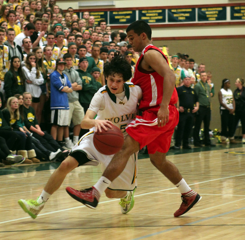 . San Ramon Valley\'s Jerry Karczewski (5) dribbles against Monte Vista\'s Rishi Satoor (12) in the first half of their varsity boys basketball game in Danville, Calif., on Friday, Feb. 15, 2013. (Anda Chu/Staff)