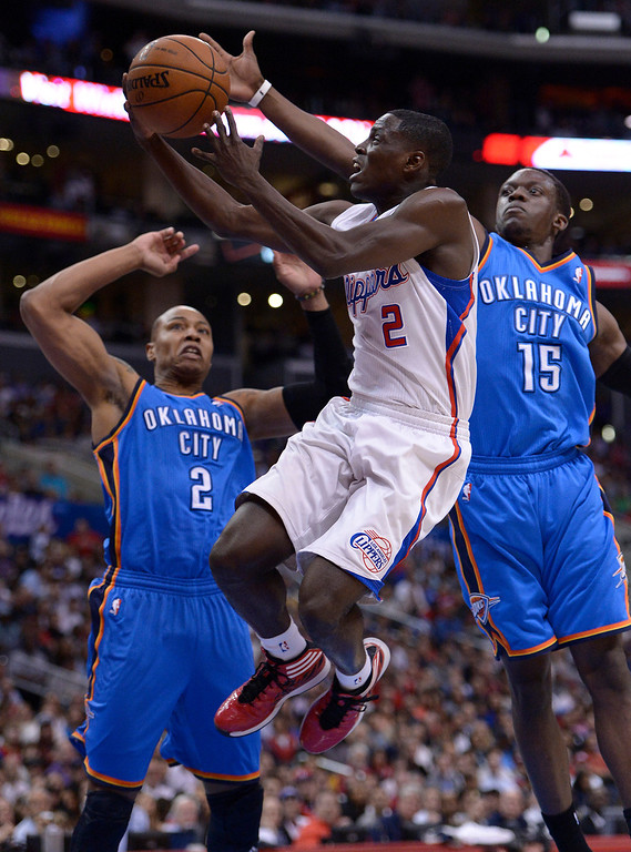 . Clippers#2 Darren Collison goes to the hoop against Thunder#2 Caron Butler and Thunder#15 Reggie Jackson in the first half. The Los Angeles Clippers played the Oklahoma City Thunder in a regular season game at Staples Center in Los Angeles, CA. 4/9/2014(Photo by John McCoy / Los Angeles Daily News)