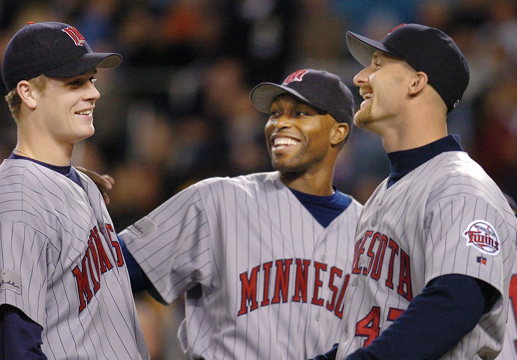 . Torii Hunter and Corey Koskie joke with Justin Morneau before the start of Game 1 of the American League Division Series at Yankee Stadium on Oct. 5, 2004. (File photo)