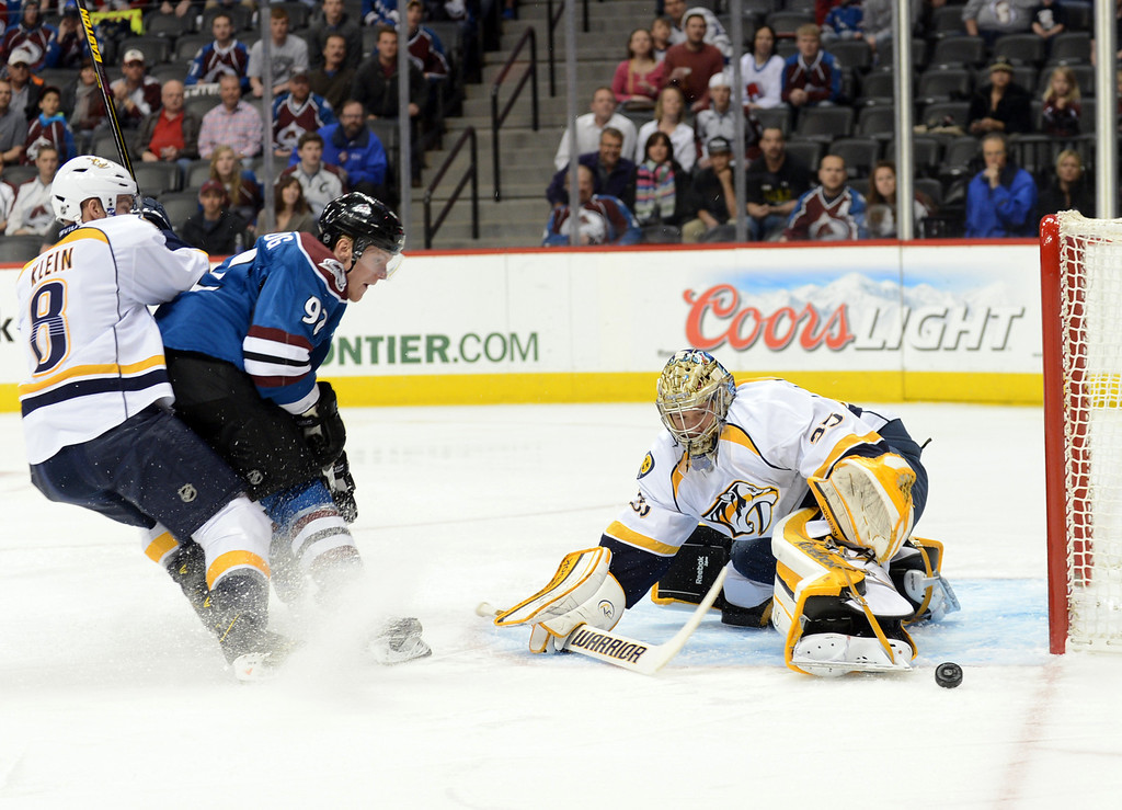 . Nashville Predators goalie Pekka Rinne (#35), right, saves the goal from the shot of Gabriel Landeskog of Colorado Avalanche (92) by Kevin Klien of Predators (#8) in the 1st period of the game at Pepsi Center. Denver, Colorado. March 30, 2013. (Photo By Hyoung Chang/The Denver Post)