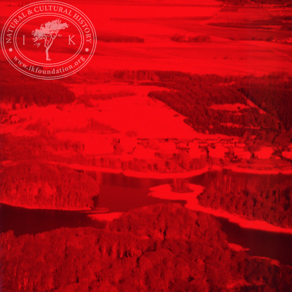 Experimental photography with red filter over landscapes with plantations, agriculture, water and settlements around Vombsjön (9 May, 1986). | LH.0220