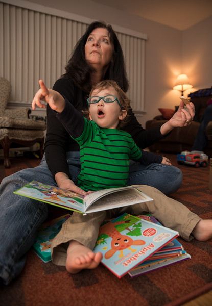 Caleb and Mimi reading distracted.jpg