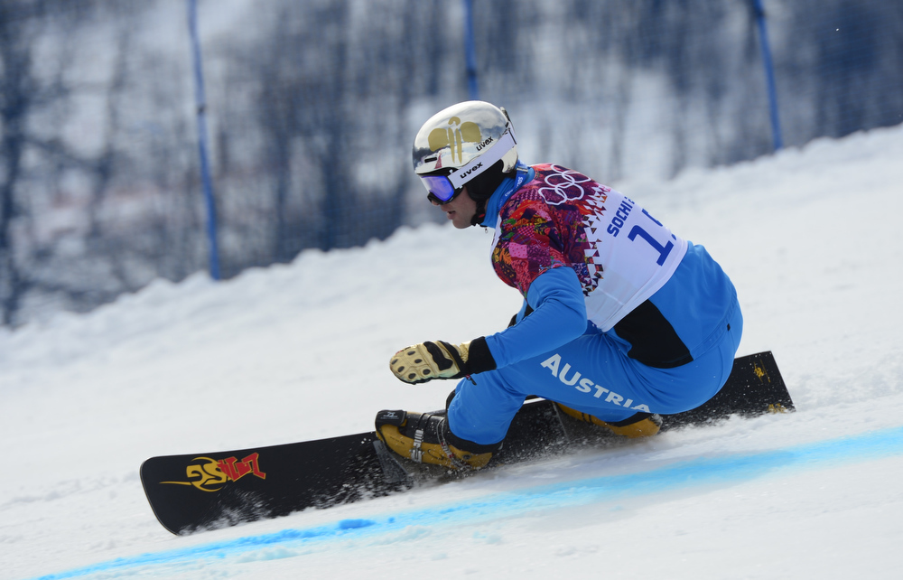. Austria\'s Benjamin Karl competes in the Men\'s Snowboard Parallel Giant Slalom 1/8 Finals at the Rosa Khutor Extreme Park during the Sochi Winter Olympics on February 19, 2014.  JAVIER SORIANO/AFP/Getty Images