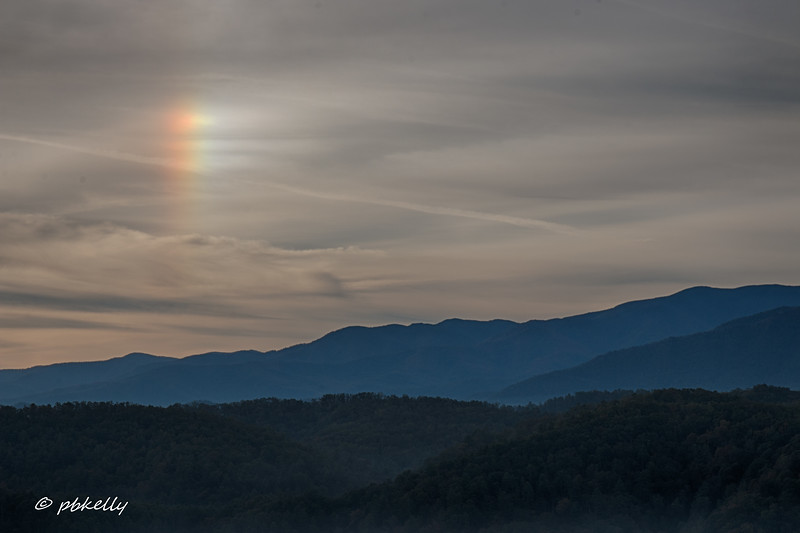 This odd phenomenon is called a Sundog.  Never seen one before.