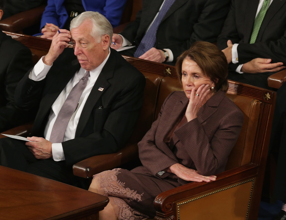 . House Minority Leader Nancy Pelosi (D-CA) (R) and House Minority Whip Steny Hoyer (D-MD)(L) listen to Israeli Prime Minister Benjamin Netanyahu speak about Iran during a joint meeting of the United States Congress in the House chamber at the U.S. Capitol March 3, 2015 in Washington, DC. At the risk of further straining the relationship between Israel and the Obama Administration, Netanyahu warned members of Congress against what he considers an ill-advised nuclear deal with Iran.  (Photo by Chip Somodevilla/Getty Images)