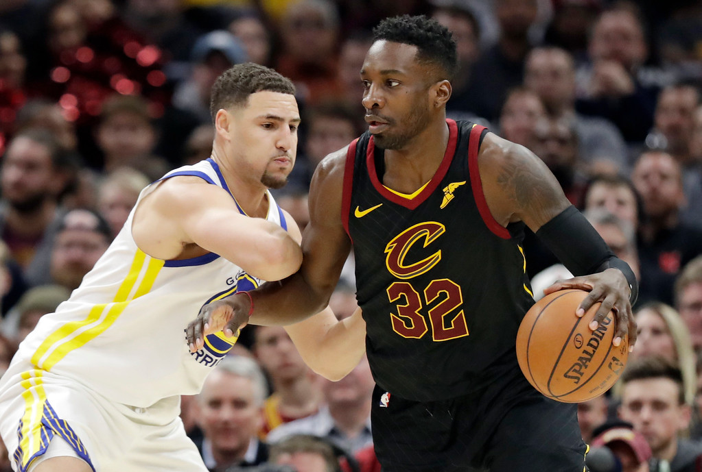 . Cleveland Cavaliers\' Jeff Green (32) drives against Golden State Warriors\' Klay Thompson (11) in the second half of an NBA basketball game, Monday, Jan. 15, 2018, in Cleveland. (AP Photo/Tony Dejak)