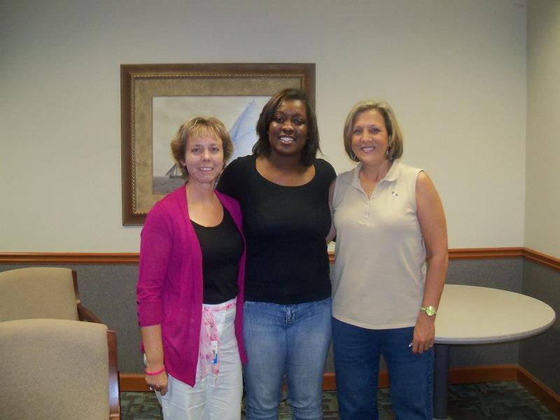 Traci Crosby, homeowner partner Latosha Todd and Kim Roberts