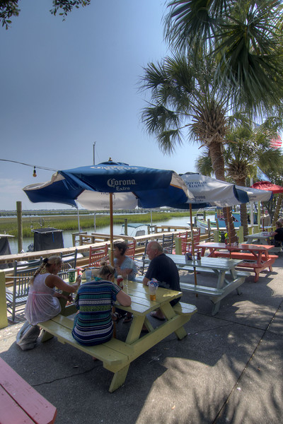 People enjoy outdoor dining along the Marshwalk at Bubba's Love Shak in Murrells Inlet, SC on Tuesday, September 10, 2013. Copyright 2013 Jason Barnette