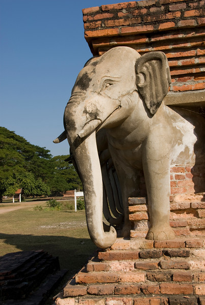 Corner shot of elephant carving in Wat Sorasak- Sukhothai, Thailand