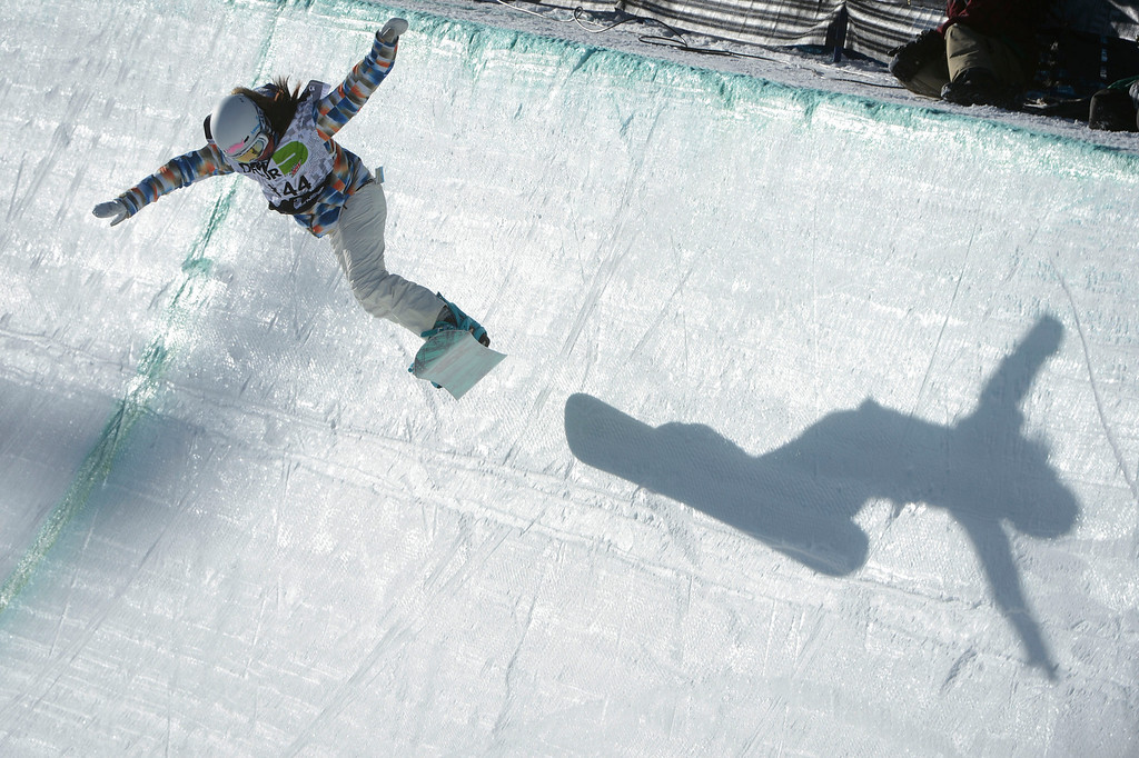 . Pro Snowboarder, Chloe Kim, 13-years-old, heads down the superpipe  at Breckenridge during the Dew Tour Ion Mountain superpipe championship finals at Breckenridge Saturday afternoon, December 14, 2013. Kim placed third with a score of 89.40 (Photo By Andy Cross/The Denver Post)
