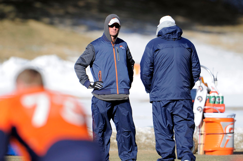 . Denver Broncos offensive coordinator Mike McCoy looks on during practice Wednesday, January 2, 2013 at Dove Valley.  John Leyba, The Denver Post