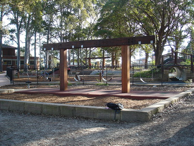 quad timber swing with sandstone edging