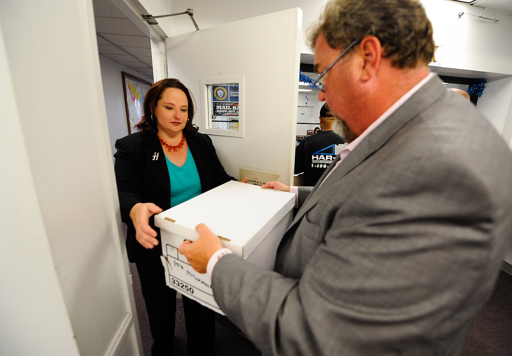 . City Clerk Gigi Hanna accepts petitions from recall proponent Scott Beard at San Bernardino City Hall on Thursday, Aug. 22, 2013. On Thursday, San Bernardino County Superior Court Judge David Cohn ordered Hanna to count the petitions to recall City Attorney James F. Penman and several City Council members. (Rachel Luna / Staff Photographer)