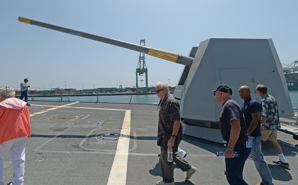 . People take a tour of the USS Spruance, an Arleigh Burke-class guided missile destroyer, which is docked in the Port of Los Angeles for Navy Days.  One of the main guns at the front of the ship. Saturday, August 09, 2014, San Pedro, CA.   Photo by Steve McCrank/Daily Breeze