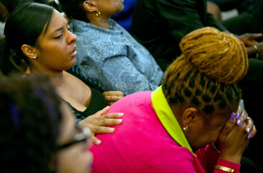 . Shaneah Jenkins, left, girlfriend of victim Odin Lloyd, cries as former New England Patriots NFL football player Aaron Hernandez is found guilty verdict during his murder trial, Wednesday, April 15, 2015, at the Bristol County Superior Court in Fall River, Mass. Hernandez was found guilty of first-degree murder in the shooting death of Lloyd in June 2013.  He faces a mandatory sentence of life in prison without parole. (Dominick Reuter/Pool Photo via AP)