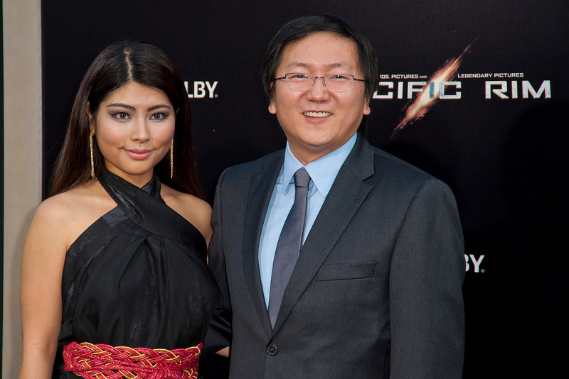 HOLLYWOOD, CA - JULY 09: Actor Masi oka and guest arrive at the premiere of Warner Bros. Pictures' and Legendary Pictures' 'Pacific Rim' at Dolby Theatre on Tuesday, July 9, 2013 in Hollywood, California. (Photo by Tom Sorensen/Moovieboy Pictures)