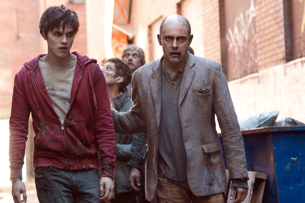 ". This film image released by Summit Entertainment shows Rob Corddry, right, and Nicholas Hoult in a scene from ""Warm Bodies.\"" (AP Photo/Summit Entertainment, Jonathan Wenk)"