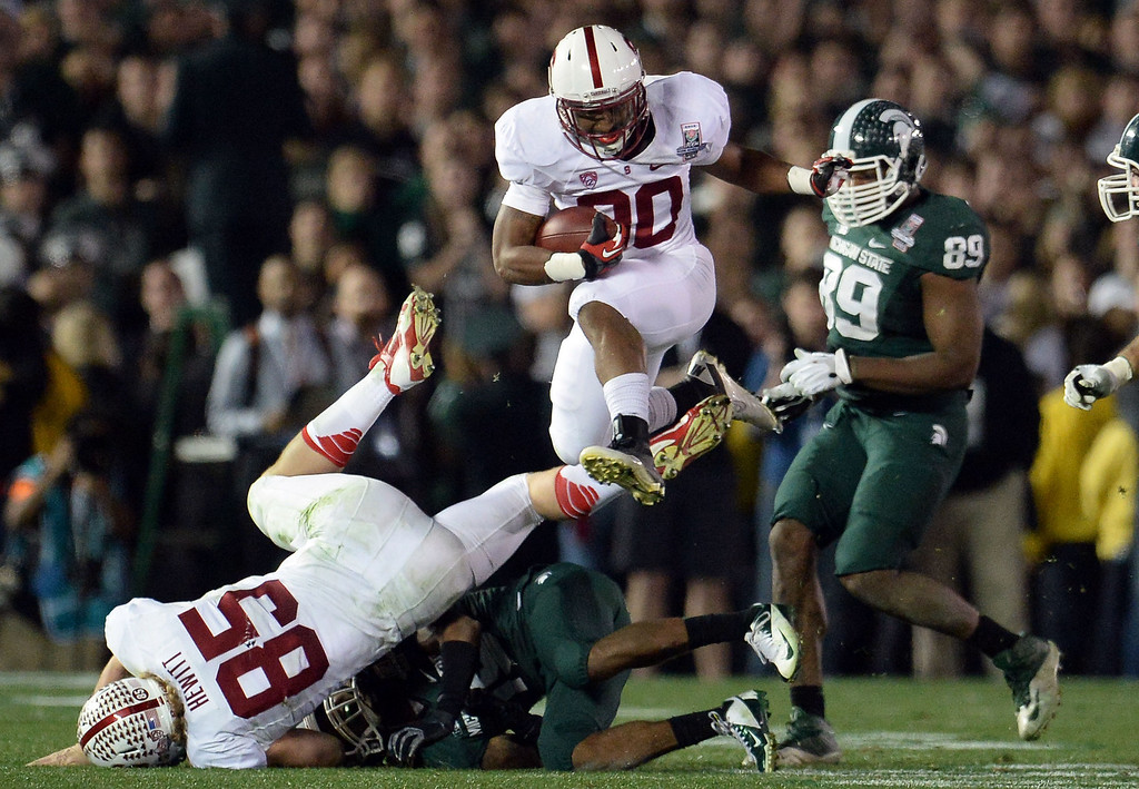 . Stanford running back Ricky Seale (30) leaps over the Michigan State defense for a first down in the second half of the 100th Rose bowl game in Pasadena, Calif., on Wednesday, Jan.1, 2014. Michigan State won 24-20.  (Keith Birmingham Pasadena Star-News)