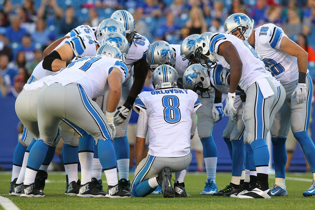 . Detroit Lions quarterback Dan Orlovsky (8) huddles with his team during the first half of a preseason NFL football game against the Buffalo Bills, Thursday, Aug. 28, 2014, in Orchard Park, N.Y. (AP Photo/Bill Wippert)