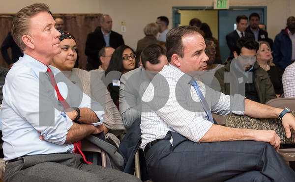 03/15/18 Wesley Bunnell | Staff Candidates for governor Ned Lamont, L, and Joe Ganim listen to fellow speakers at the Pulaski Club on Thursday evening during a meeting for Democratic candidates for state office to meet with the Democratic Town Committee as well as New Britain residents.