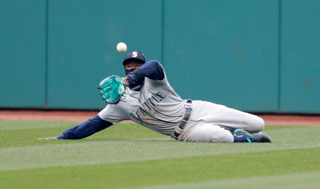 . Seattle Mariners\' Dee Gordon dives for a ball hit by Cleveland Indians\' Michael Brantley during the sixth inning of a baseball game Saturday, April 28, 2018, in Cleveland. Brantley was safe at second base for a double. (AP Photo/Tony Dejak)