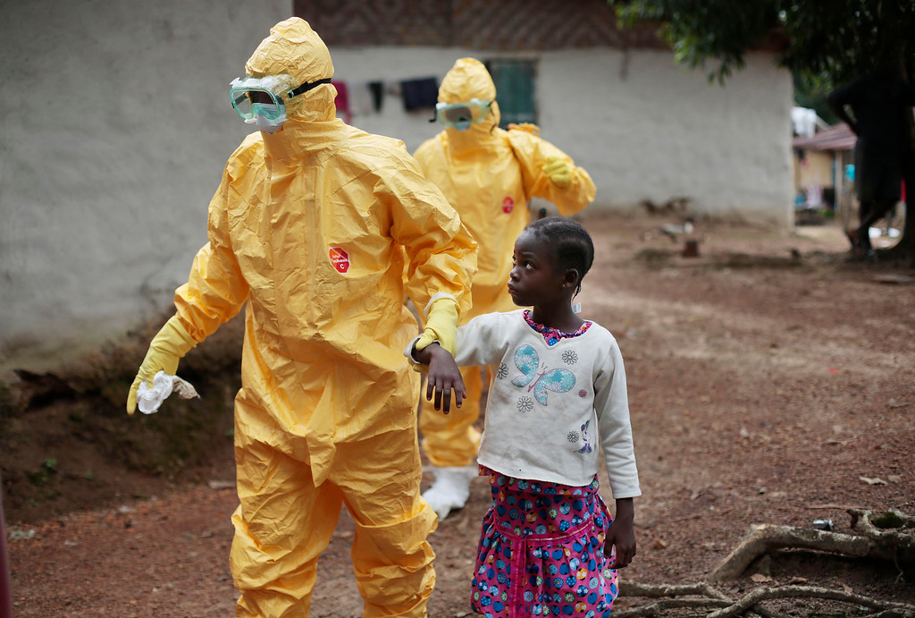 . Nine-year-old Nowa Paye is taken to an ambulance after showing signs of the Ebola infection in the village of Freeman Reserve, about 30 miles north of Monrovia, Liberia,Tuesday Sept. 30, 2014. (AP Photo/Jerome Delay, File)