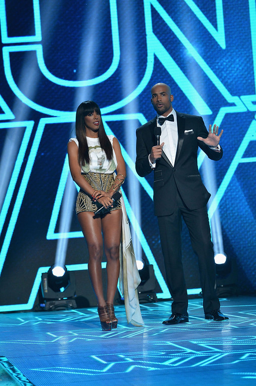 . Hosts Kelly Rowland and Boris Kodjoe on stage at BET\'s Rip The Runway 2013:Show at Hammerstein Ballroom on February 27, 2013 in New York City.  (Photo by Rick Diamond/Getty Images for BET\'s Rip The Runway)