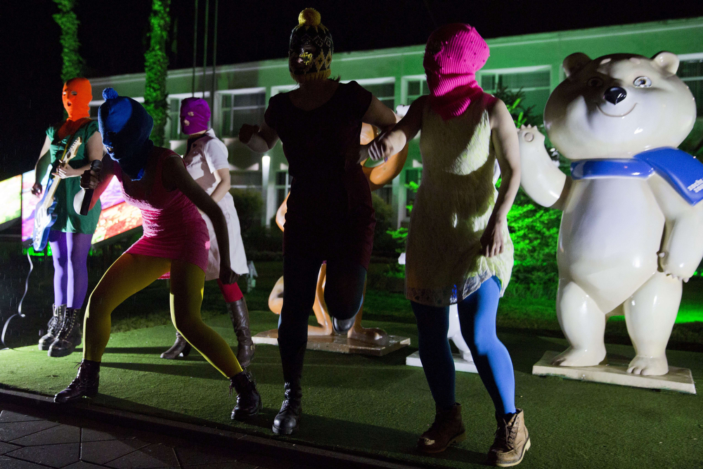. Members of Russian punk group Pussy Riot, Nadezhda Tolokonnikova (front L) and Maria Alyokhina (front R) perform in front of Sochi 2014 Winter Olympic games mascots as they record a video in the Adler district of Sochi, early on February 18, 2014. Tolokonnikova and Alyokhina and at least half a dozen others were arrested today in the centre of the Winter Games host city over accusations of theft from a local hotel. (EVGENY FELDMAN/AFP/Getty Images)