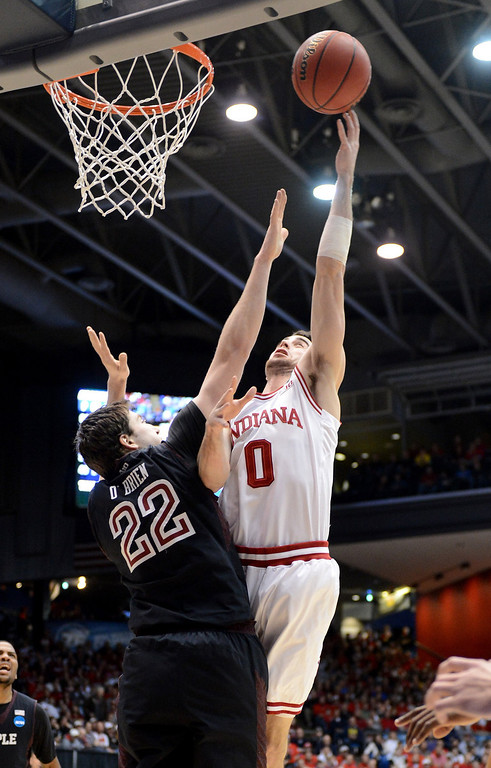 . Will Sheehey #0 of the Indiana Hoosiers drives to the basket against Jake O\'Brien #22 of the Temple Owls in the first half during the third round of the 2013 NCAA Men\'s Basketball Tournament at UD Arena on March 24, 2013 in Dayton, Ohio.  (Photo by Jason Miller/Getty Images)